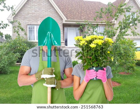 Gardening people. Couple with flowers in the garden. - stock photo