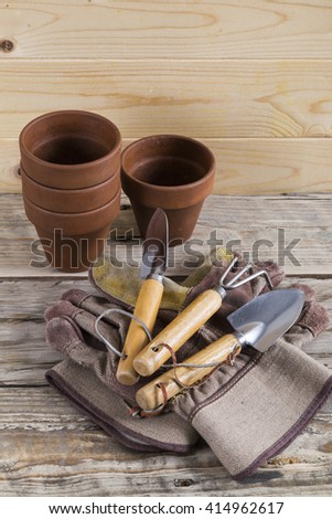 Gardening pots tools and gloves - stock photo