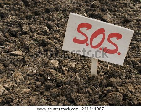 Gardening sos, clay soil, urgent problem. - stock photo