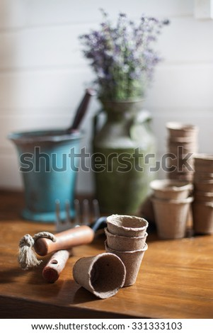 gardening still life with old vase and mortar and pestle - stock photo