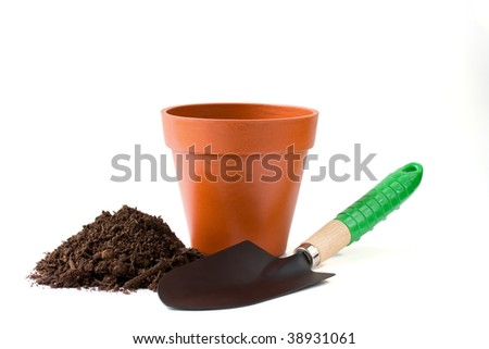 Gardening tool with dirt and flower pot - stock photo
