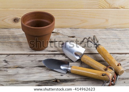 Gardening tools with pot - stock photo