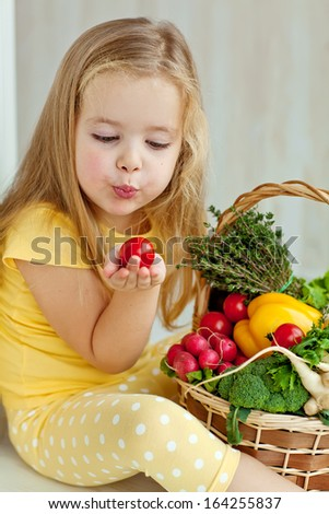 Gardening, vegetables - lovely girl with the basket of ecological harvests - stock photo