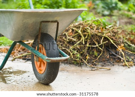 Gardening wheelbarrow - stock photo