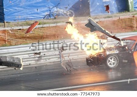 GARDERMOEN RACEWAY, NORWAY - MAY 14: Race car explodes into flames during a drag race on May 14,2011 at Gardermoen Raceway, Norway. Parts spreads all over the track. - stock photo