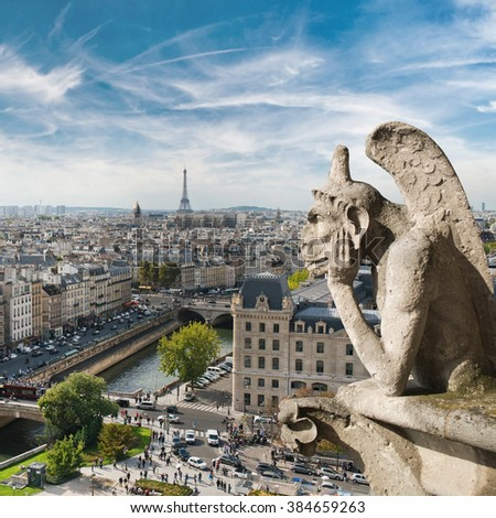 Gargoyle and city view from the roof of Notre Dame de Paris - stock photo