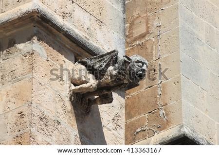Gargoyle in the cathedral of Palma de Mallorca, Spain - stock photo