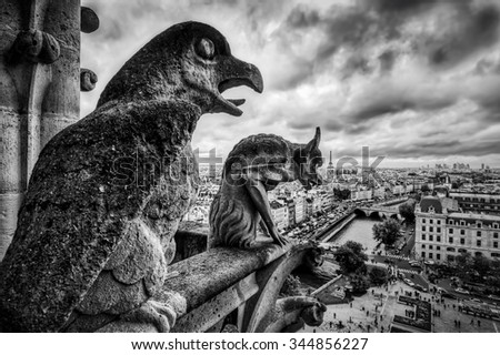 Gargoyles and chimera statues of Notre Dame over Paris, France skyline. Dark clouds, vintage black and white - stock photo