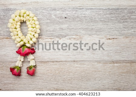 Garland on white wooden background - stock photo