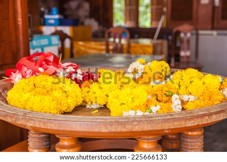 Garlands of marigolds for religious ceremonies - stock photo