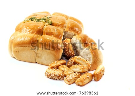 Garlic bread and biscuits on an white background. - stock photo