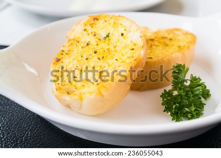 Garlic Bread on white plate - stock photo