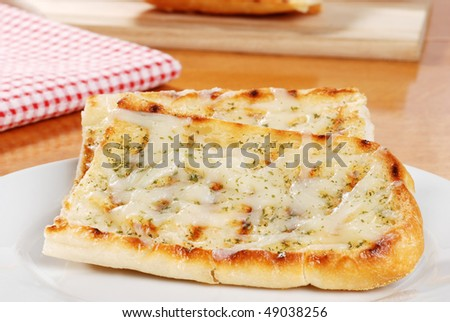 garlic bread with cheese - stock photo