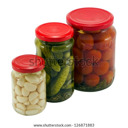 garlic cucumber tomatoes canned preserved in glass pots jars isolated on white background ecological natural food resource for winter - stock photo