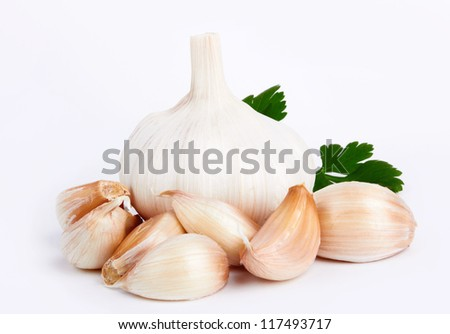 garlic decorated parsley leaves on white background - stock photo