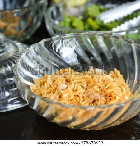 Garlic in beaker - stock photo