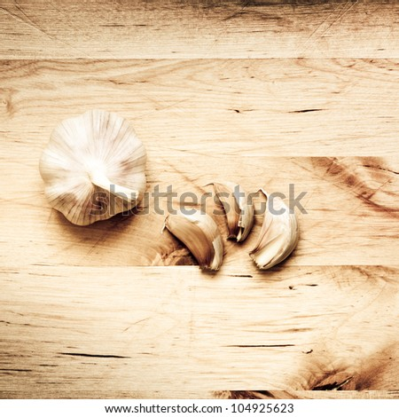 Garlic on chopping board - stock photo