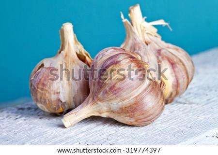 Garlic on wooden table - stock photo