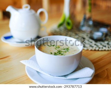 Garlic soup on a wooden table in a restaurant. - stock photo