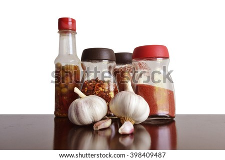 garlic, spices and condiments for food Center - stock photo
