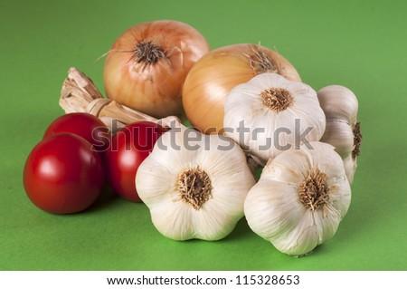 Garlic, tomatoes and onion - stock photo
