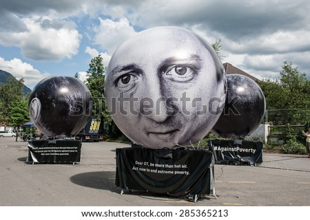 GARMISCH-PARTENKIRCHEN, GERMANY - JUNE 07: Activists have installed balloons decorated with the portraits of the seven presidents guests to G7 Summit. The British Prime Minister David Cameron - stock photo