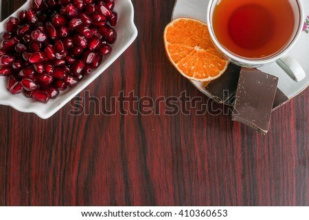 garnet bowl and spicy tea with orange and chocolate - stock photo