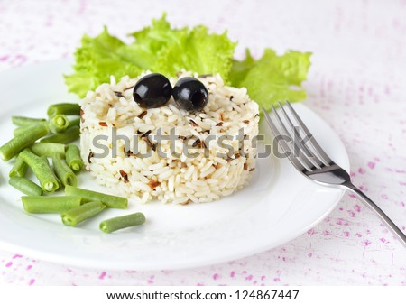 Garnish - Bowl of cooked mixed wild Rice. Plate Served with salad and green bean vegetable. - stock photo