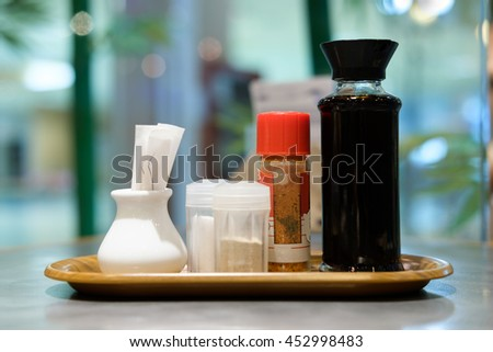 Garnish with salt , pepper, soy sauce on the table in a Japanese restaurant . - stock photo