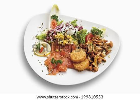 Garnished smoked salmon served on plate - stock photo