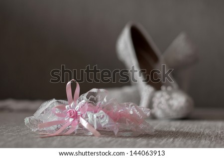 garter with shoes. Wedding background - stock photo