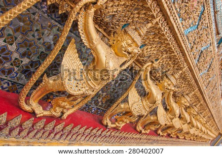 Garuda in Wat Phra Kaew, Temple of the Emerald Buddha, Grand Palace, Thailand. - stock photo