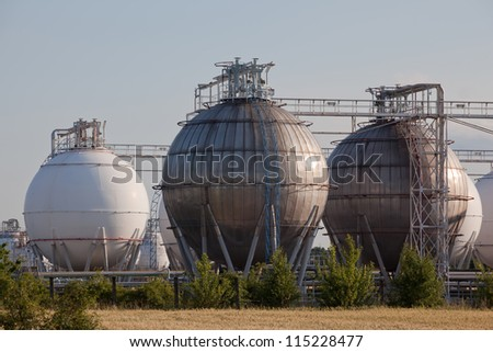 Gas and chemical refinery tanks - stock photo