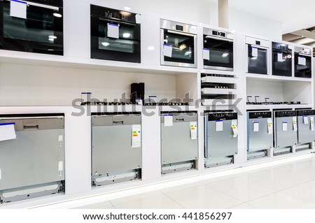 Gas and electric ovens and other home related appliance or equipment in the retail store showroom - stock photo