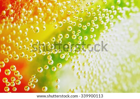 Gas bubbles in the carbonated beverage. Lemonade cocktail. Transparent. Gases, carbon dioxide. Citrus cocktail bar. Cocktails. The background texture. Macro photo. Lots of bubbles. - stock photo