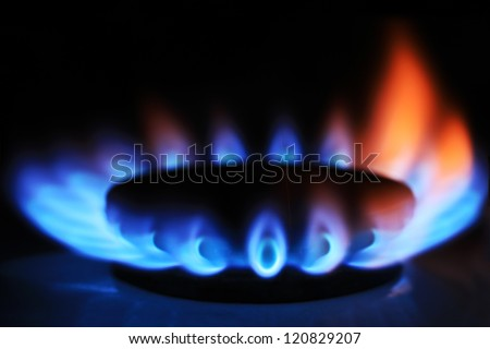 Gas burner on stove. Selective focus. - stock photo