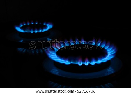 Gas cooker. Two rings of flame - stock photo