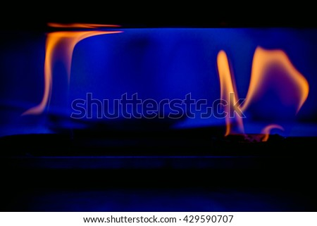 Gas Fire,Gas burning abstract background.Burning gas on the kitchen gas stove. - stock photo
