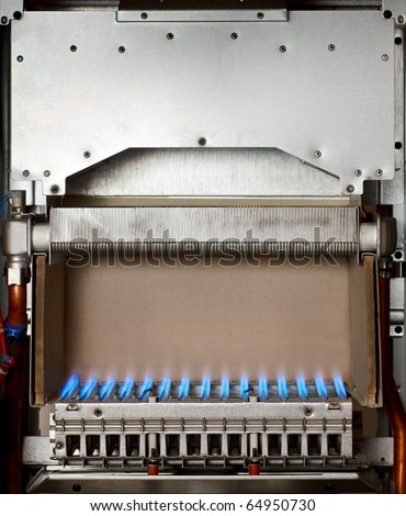 Gas flame inside of the gas boiler - stock photo