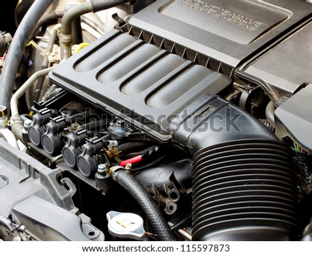gas injector installed in gasoline engine to use cheaper alternative fuel - stock photo
