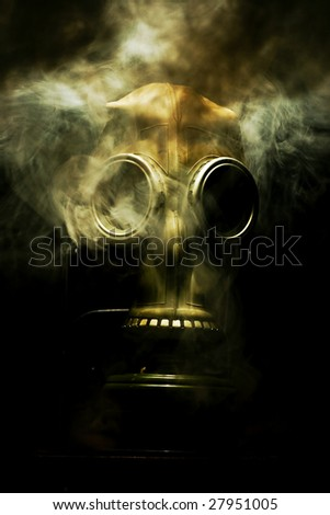Gas mask with smoky background isolated on black - stock photo