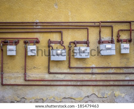 gas meters on an old building - stock photo