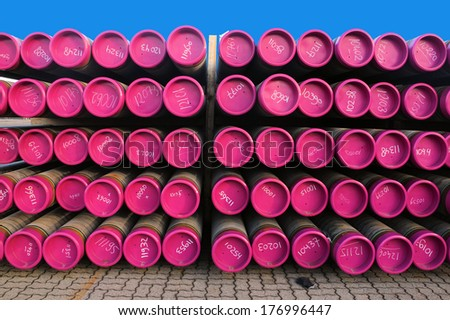 Gas pipes with plastic cover in a storage - stock photo