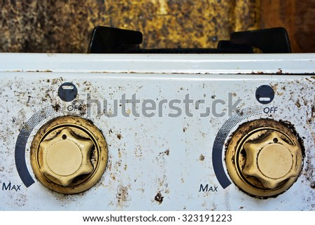GAS RANGE BUTTONS OF THE OLD WHITE STAINED GAS STOVE - stock photo