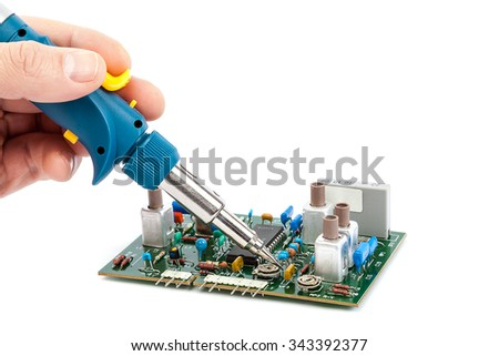 Gas soldering iron in hand and the board with chips isolated on a white background. - stock photo