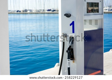 Gas station for ships and boats on the port - stock photo