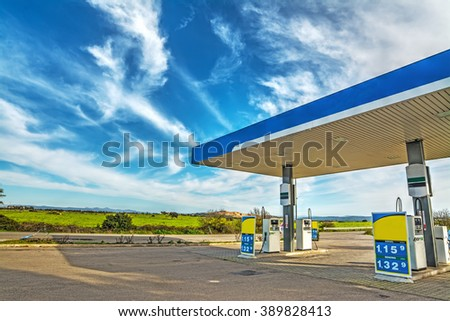 gas station under a cloudy sky in Italy - stock photo