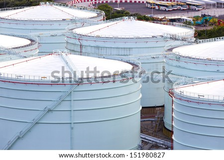 Gas storage tank in industrial plant - stock photo