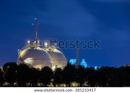 Gas storage tanks and a large oil - refinery plant - stock photo