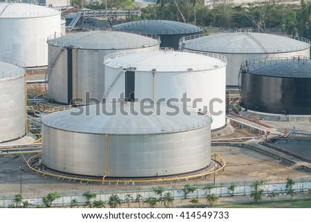 gas storage tanks and oil tank in industrial plant - stock photo